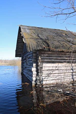 rural wooden house amongst spring flood Stock Photo - 9492672