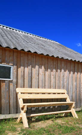 wooden bench near wooden wall photo
