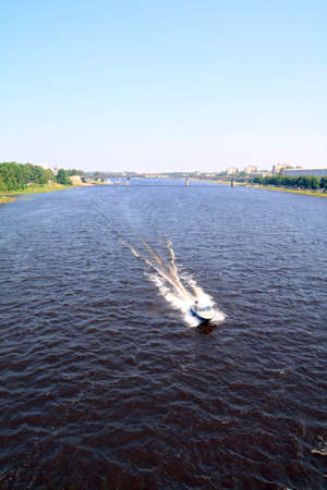 quick motor boat on river amongst waves photo