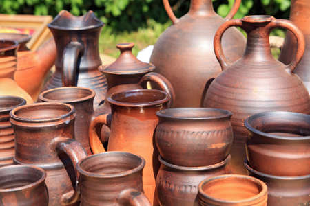 clay pitchers on rural market photo