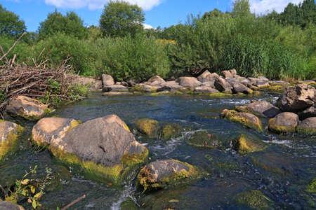 mountain river flow between stone photo