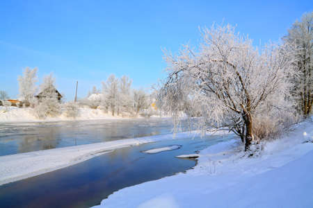 winter village on coast river Stock Photo - 10798309