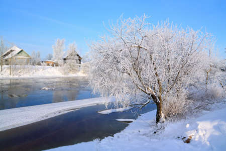winter village on coast river  Stock Photo - 10798312
