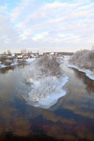 snow village on coast river photo
