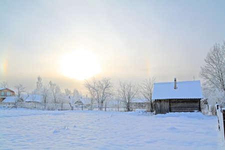winter sun on snow village photo