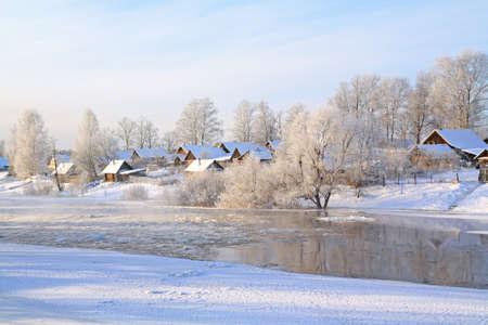 snow village on coast river Stock Photo - 10811706