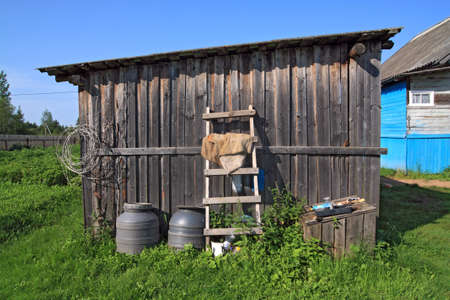 rural shed on green herb