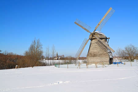 aging mill on snow field photo