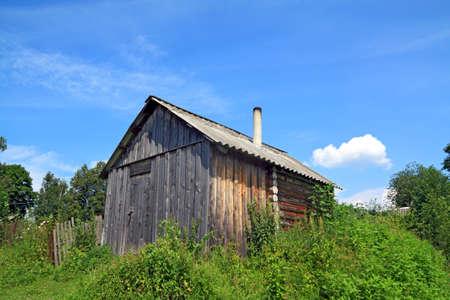 grungey: wooden rural house amongst herbs Editorial