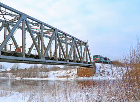 train on bridge through river  photo