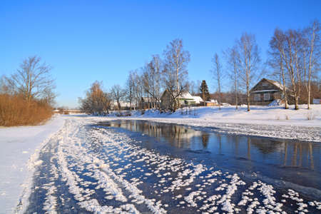 winter village on coast river  photo