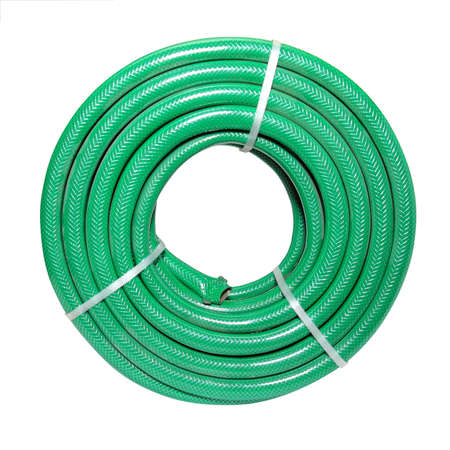 coiled: green hose on white background