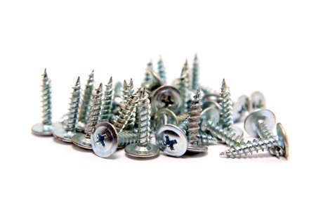 steel screws on white background photo