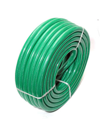 irrigation equipment: green hose on white background