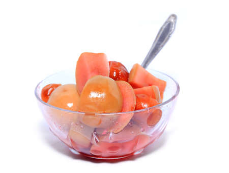 canned apple in transparent plate photo