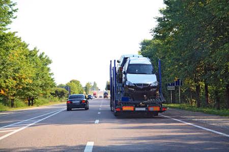 cargo cars on asphalt road