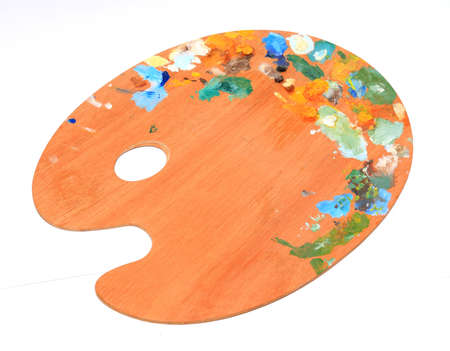 daubed: palette with paint on white background