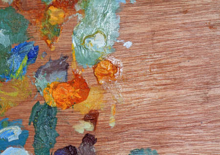 wooden palette with oil paint photo
