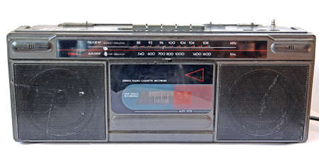 80 plus years: old cassette tape-recorder on white background