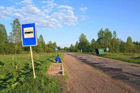 bus stop on rural road photo