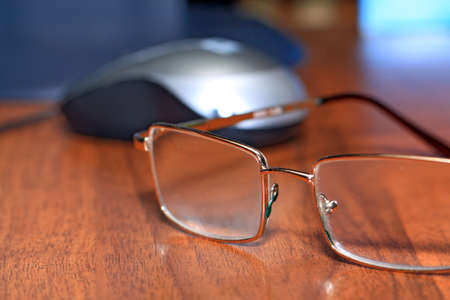 nearsighted: spectacles on wooden table Stock Photo
