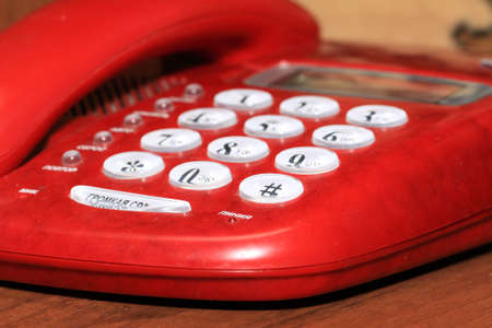 old red telephone on wooden table Stock Photo - 12881112
