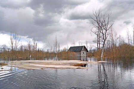 old rural house in water  photo