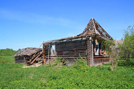 penal institution: old ruined wooden rural house Stock Photo