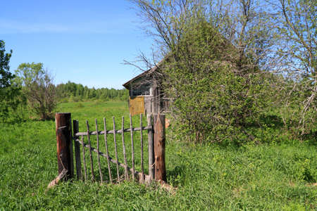 penal institution: wicket near old wooden rural building Stock Photo