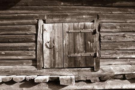 wooden door in rural barn, sepia photo