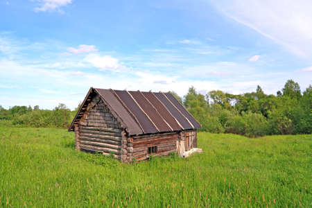penal institution: old rural house on green field