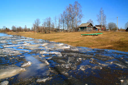 driving of ice on river to will to villages photo