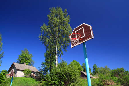 basketball ring on blue background photo