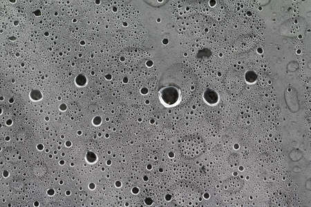 dripped: rain dripped on gray cellophane Stock Photo