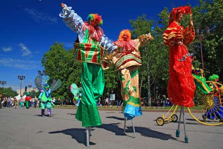 novgorod: VELIKIJ NOVGOROD, RUSSIA - JUNE 10: clowns on town street at day of the city Veliky Novgorod, Russia at June 10, 2012