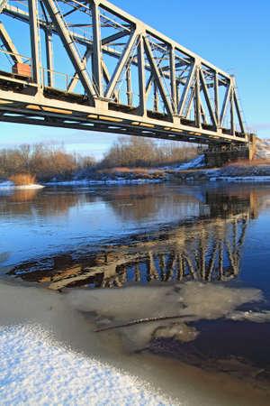 outbound: railway bridge through small river  Stock Photo