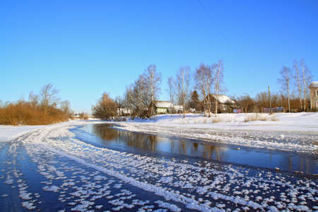 winter village on coast river  photo