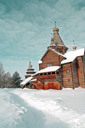 wooden chapel in winter village photo