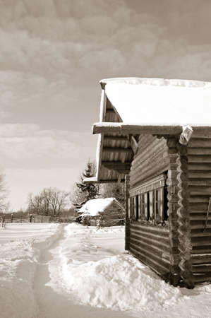 old wooden house in village , sepia photo