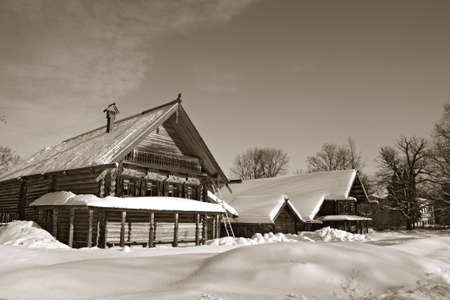 wood abandoned: old wooden house in village , sepia Stock Photo