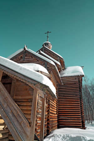 wooden chapel on blue background photo
