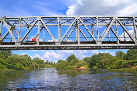 steel arch bridge: railway bridge through small river  Stock Photo