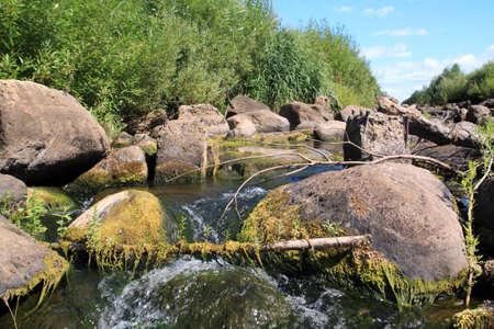 murmur: quick river flow amongst stone  Stock Photo