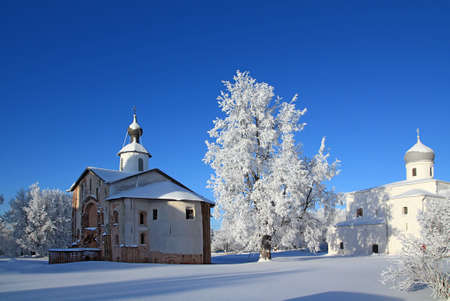 christian orthodox church on snow field photo