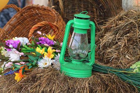 aging kerosine lamp in hay photo