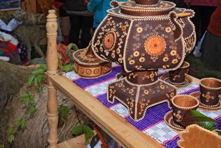decorative samovar on rural market photo