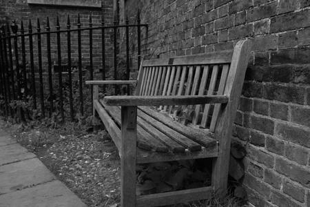 parish: Monochrome of bench outside Hampstead Heath Parish Church Stock Photo