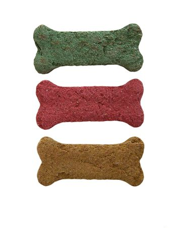 Photo of three dog bisquits/bones in different colors