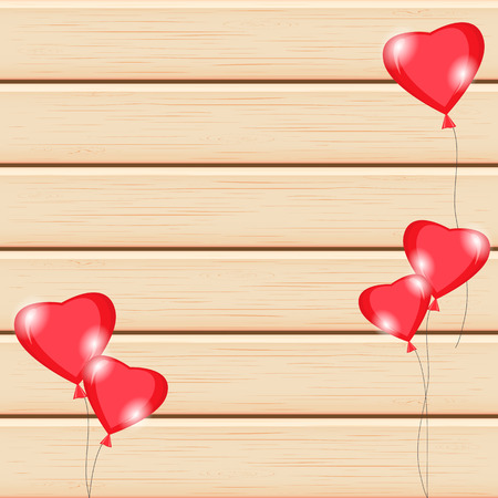 Wooden texture background, flying air balloons in the shape of a heart.Romantic composition.Greeting card,invitation for Valentines Day,birthday.Blank space for text.Board arranged horizontally