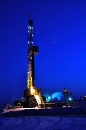 oilfield: Drilling Rig at Night. Oil fields in Western Siberia Stock Photo